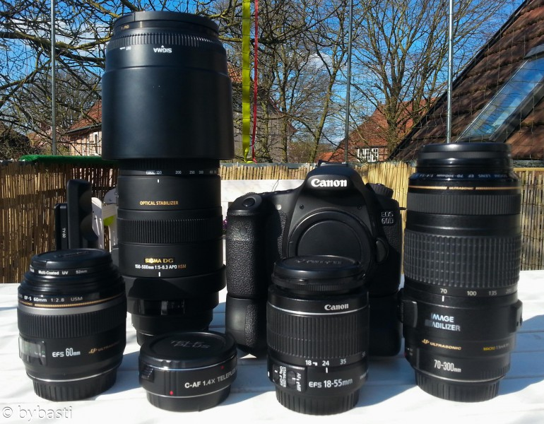 And that's my equipment, beginning with the the front row: Canon Macro Lens EF-S 60mm  C-AF 1.4x Teleplus Tele Converter Canon EF S 18-55mm  Canon EF 70-300mm IS USM  Back row:  Sigma 150-500mm Canon EOS 60D with battery grip